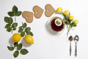 Ornament of lemons, cookies and rose leaves on white background. Recipe of gingerbread