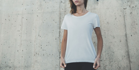 Mock-up of blank white t-shirt, young hipster girl wearing template white t-shirt with empty space for your logo or design