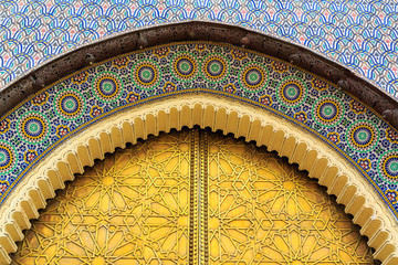 Entrance door with mosiac and brass door at the Royal palace in Fez