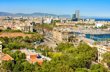 Barcelona cityscape. Aerial view seen from Montjuic hill. Barcelona port. Columbus monument.