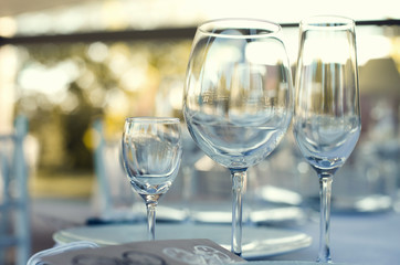 Close up picture of empty glasses in restaurant. Selective focus