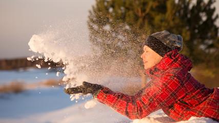 a girl throws snow