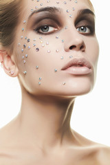 beautiful woman with crystals on face.beauty girl