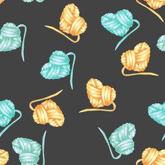 Seamless pattern with watercolor yellow and blue heart ball of yarn; hand drawn on a dark background