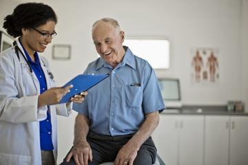 Smiling senior man receiving good news at his annual medical check up.