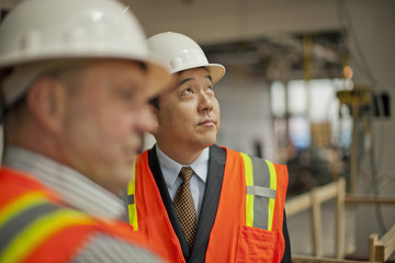 Middle aged businessman observing a construction site.