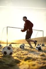 Jogger running across a soccer field.