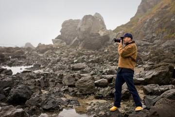 A photographer at the beach.