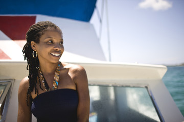 Portrait of young woman on boat deck.