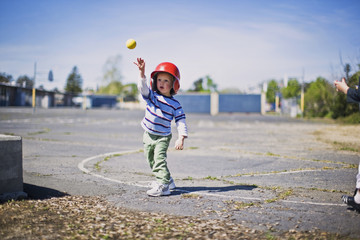 Little boy throwing baseball