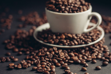 coffee beans, black background, cup, saucer
