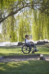 Boy in wheelchair in park