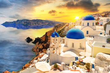 Beautiful sunset over Oia town on Santorini island, Greece