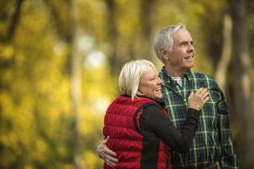 Senior couple embracing.