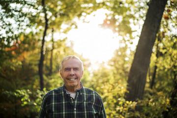 Senior man in the woods.