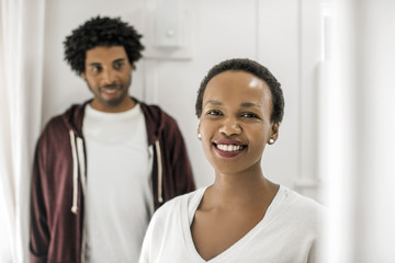 Portrait of a smiling couple inside their home.
