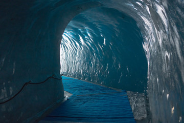 The tunnel in old glacier in MontBlanc mountains, French Alps