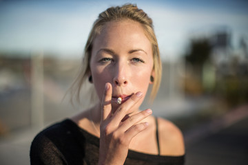 Blonde woman smoking