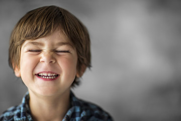 Portrait of a happy young boy pulling a funny face.