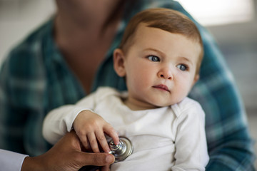 Close-up of baby boy having a medical check-up