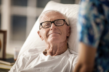Portrait of an elderly rest home patient in bed.