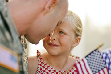 Close-up of a girl looking at her father