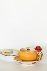 Beautiful handmade orange cup with red rose