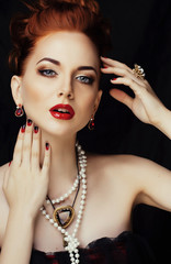 beauty stylish redhead woman with hairstyle and manicure wearing jewelry pearl close up