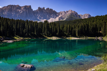 Fototapete - View of Karersee (Lago di Carezza), one of the most beautiful alpine lakes in the Italian Dolomites.