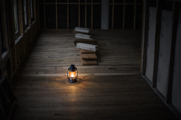 Oil lantern illuminating a cabin under construction.