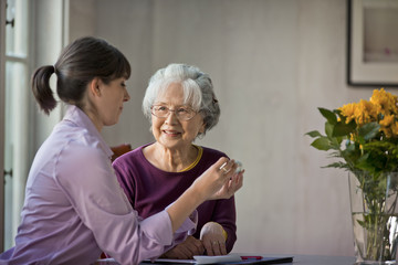Elderly woman speaking with her doctor.