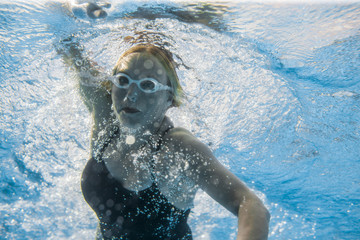 Female swimmer under the water.