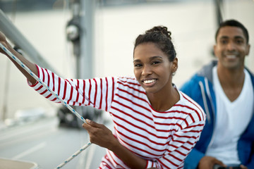 Portrait of a smiling young woman sitting on a boat.
