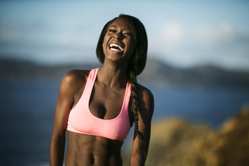 Laughing young woman wearing a crop top.