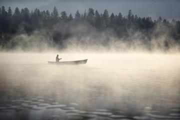 canoe on lake in the fog