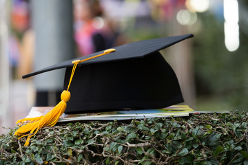 black graduation cap with blurred background.