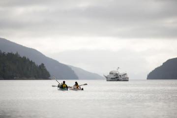 People kayaking on a lake.