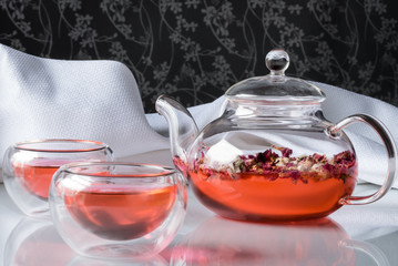 Rosebud tea in teapot with double wall cups