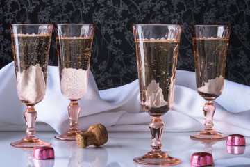 Pink Champagne flute with bubbly and chocolate hearts with pink foil