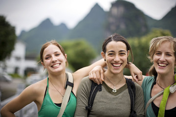 Portrait of three young adult girls travelling.