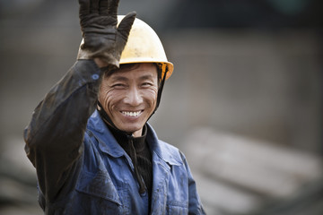 Portrait of smiling construction worker on site