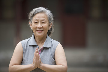 Portrait of a senior woman practicing yoga.