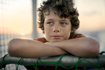 Portrait of a thoughtful young boy on a boat.