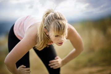 Young woman resting during a run