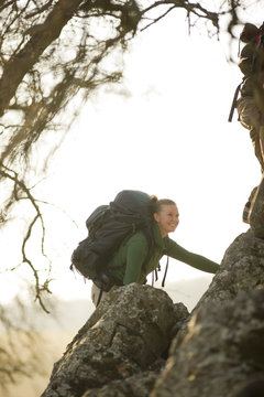 Happy young woman out hiking.