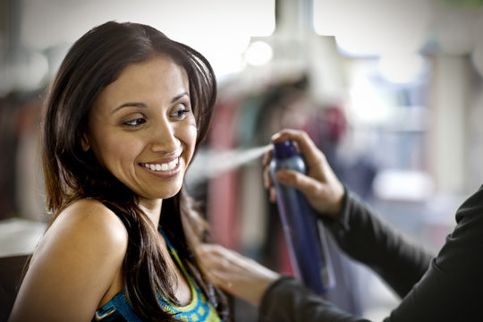 Young woman getting her hair done at a salon