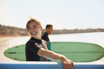 Portrait of young female surfer at the beach.