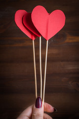 Red paper hearts on a stick