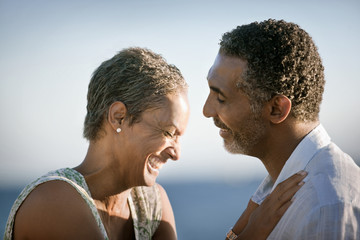 Close-up of mature couple laughing together