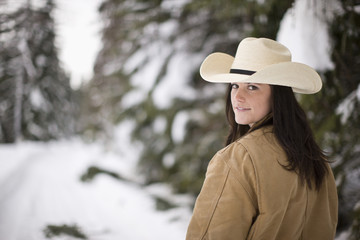 Portrait of young woman wearing cowboy hat on winter's day